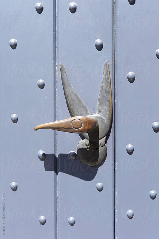 Antique doorhandle shaped like a bird by Marcel for Stocksy United