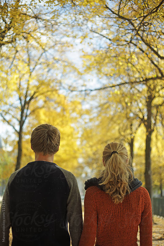 Young couple walking in autumn by Marcel for Stocksy United