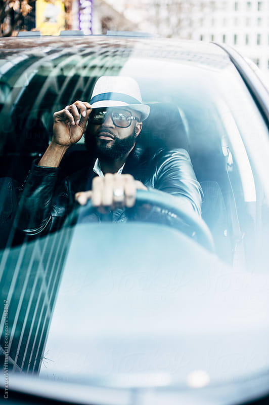 Stylish black man in his car by Cameron Whitman for Stocksy United