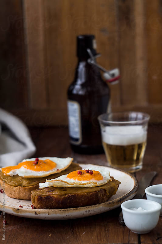 Fried egg sandwich by Viktorné Lupaneszku for Stocksy United