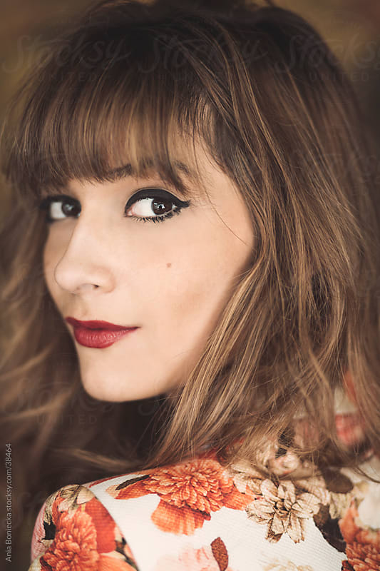 A close up portrait of a beautiful woman with a mole by Ania Boniecka for Stocksy United