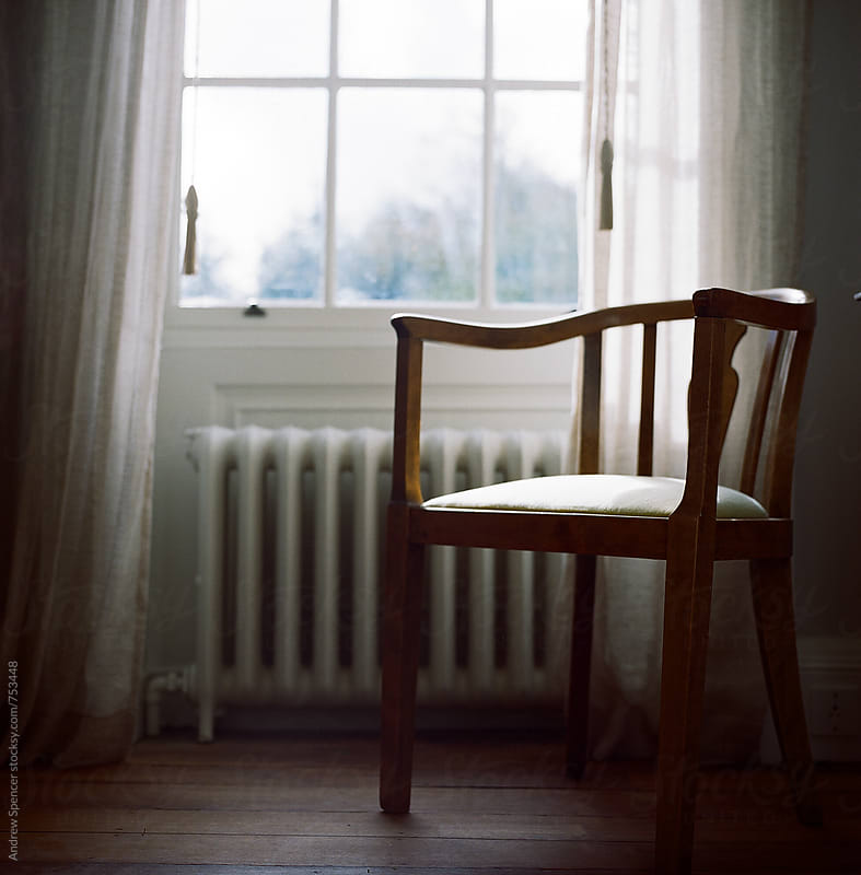 Chair in the window by Andrew Spencer for Stocksy United