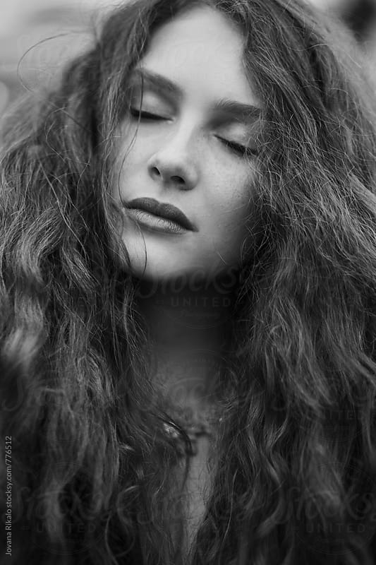 Black and white portrait of a beautiful young woman with freckles by Jovana Rikalo for Stocksy United