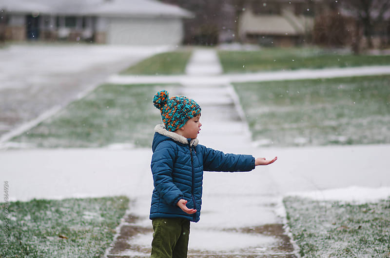 Catching Snowflakes by Ali Deck for Stocksy United