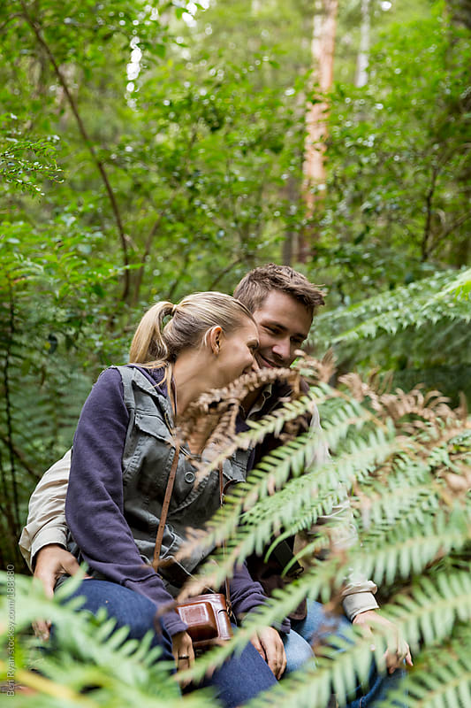 Young couple being intimate in Australian bush by Ben Ryan for Stocksy United