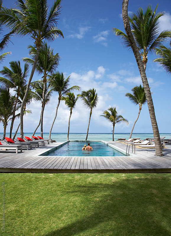 Couple relaxing on vacation at luxury resort in the Caribbean  by Trinette Reed for Stocksy United