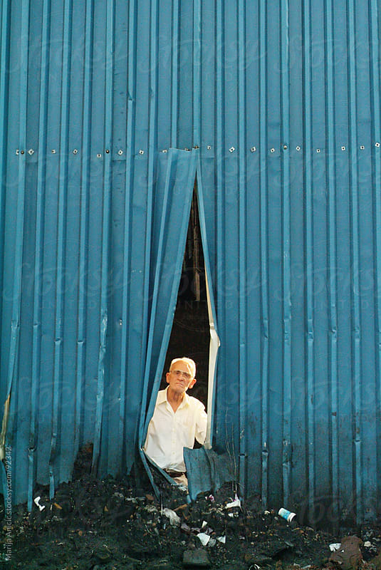 man in the blue cracked tin by Marija Anicic for Stocksy United