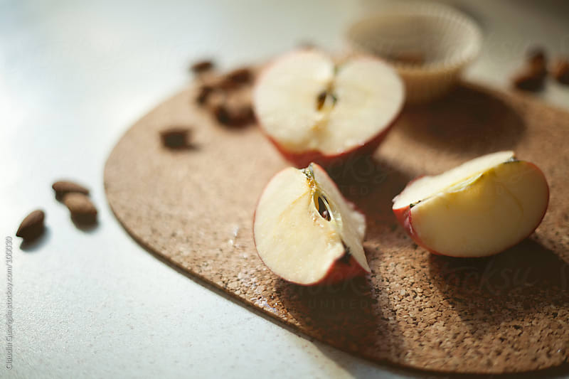 Apple and almonds by Claudia Guariglia for Stocksy United