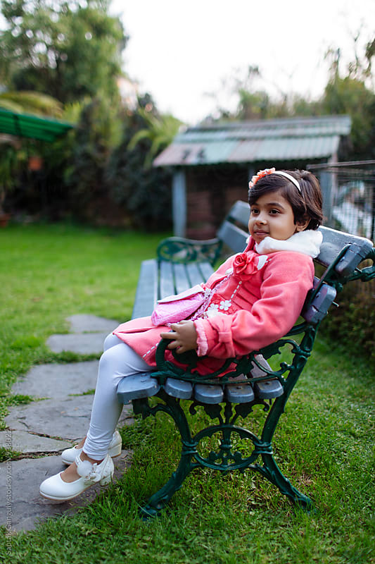 Little girl relaxing at the lawn by Saptak Ganguly for Stocksy United