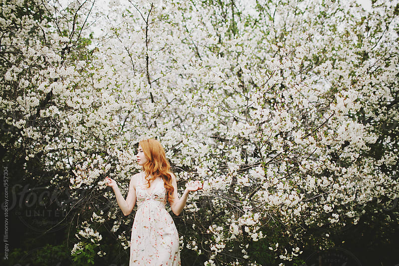 Girl and blossoming spring tree by Sergey Filimonov for Stocksy United