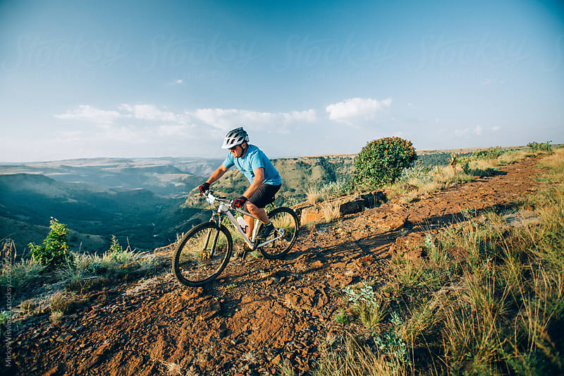 Mountain biker on a scenic mountain trail by Micky Wiswedel for Stocksy United