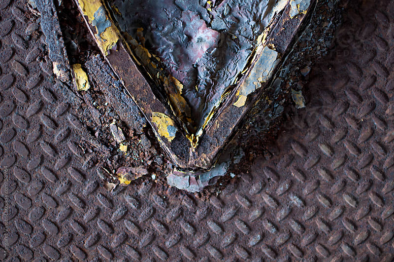 details of decaying industrial pieces by Margaret Vincent for Stocksy United