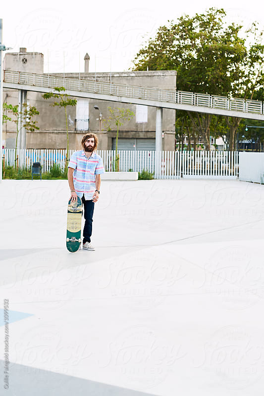 Bearded skater looking away by Guille Faingold for Stocksy United