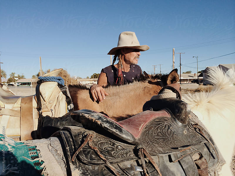 Cowboy With Mules by Kevin Russ for Stocksy United