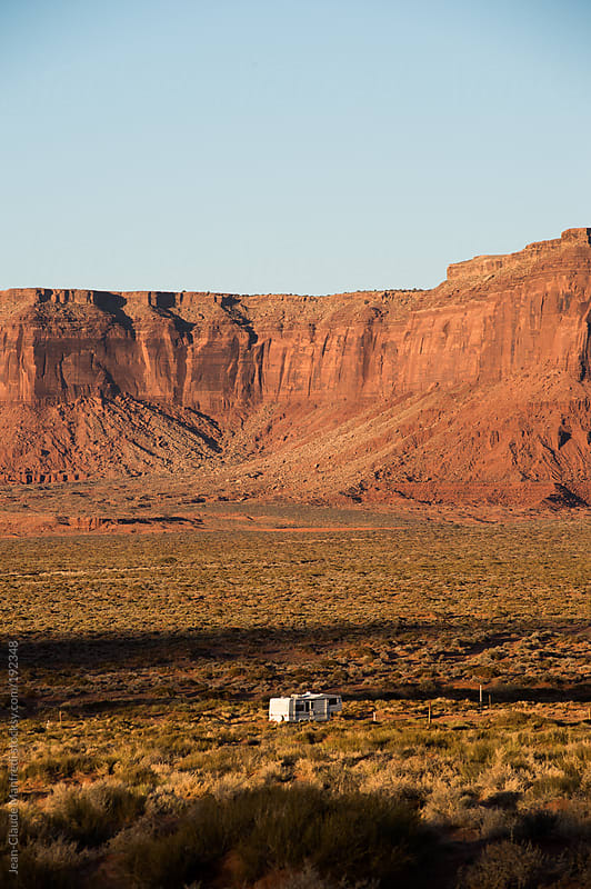 Live in the middle of nowhere, Monument Valley Navajo tribal park by Jean-Claude Manfredi for Stocksy United