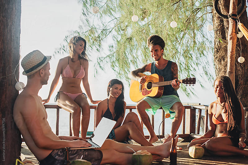 Man Plays the Guitar for His Friends by Lumina for Stocksy United