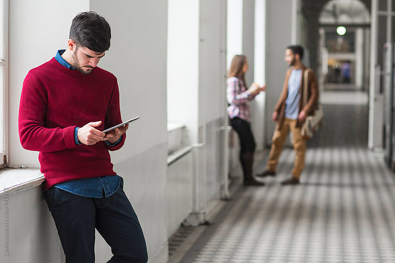 Student with Tablet on the Campus by Lumina for Stocksy United