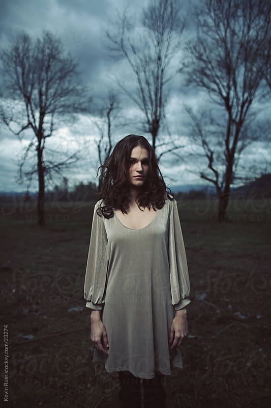 Dark Clouds Woman by Kevin Russ for Stocksy United