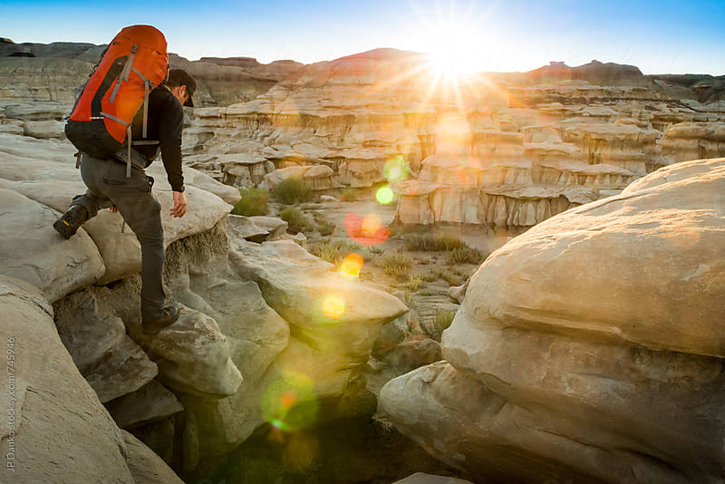 Backpacking in Bisti Badlands Wilderness Area New Mexico at Sunrise by JP Danko for Stocksy United