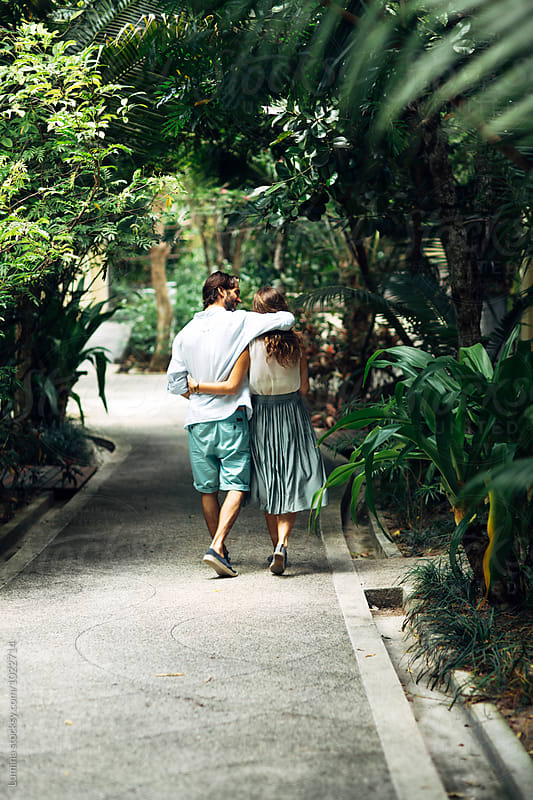 Couple Having a Walk in a Garden by Lumina for Stocksy United