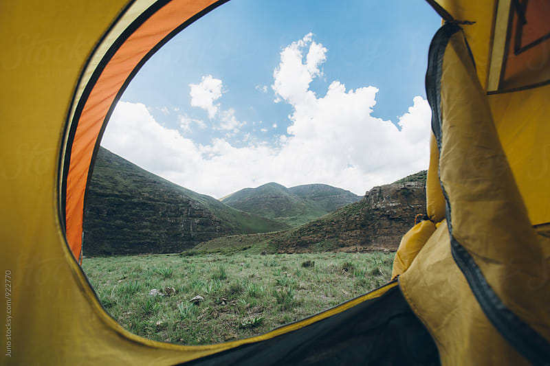 mountain wilderness view from inside a tent by Micky Wiswedel for Stocksy United