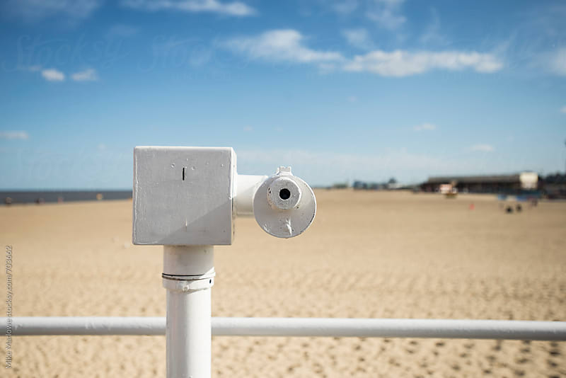 A telescope in a remote location at a beach on a bright sunny day by Mike Marlowe for Stocksy United