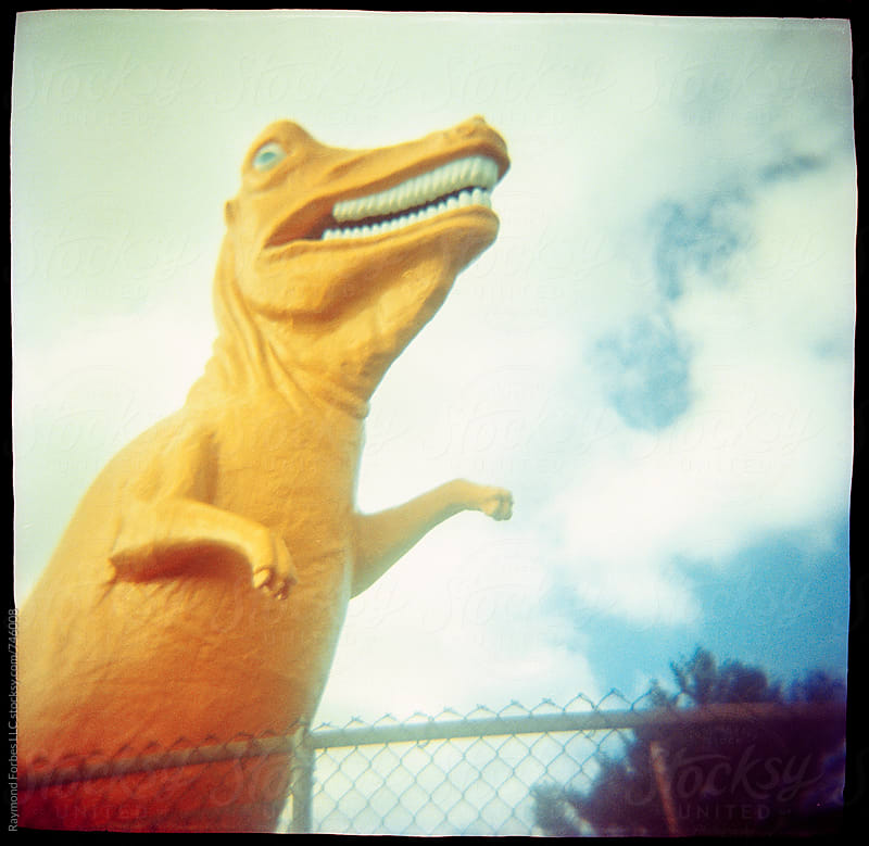 tyrannosaurus Rex at Mini Golf Park by Raymond Forbes LLC for Stocksy United