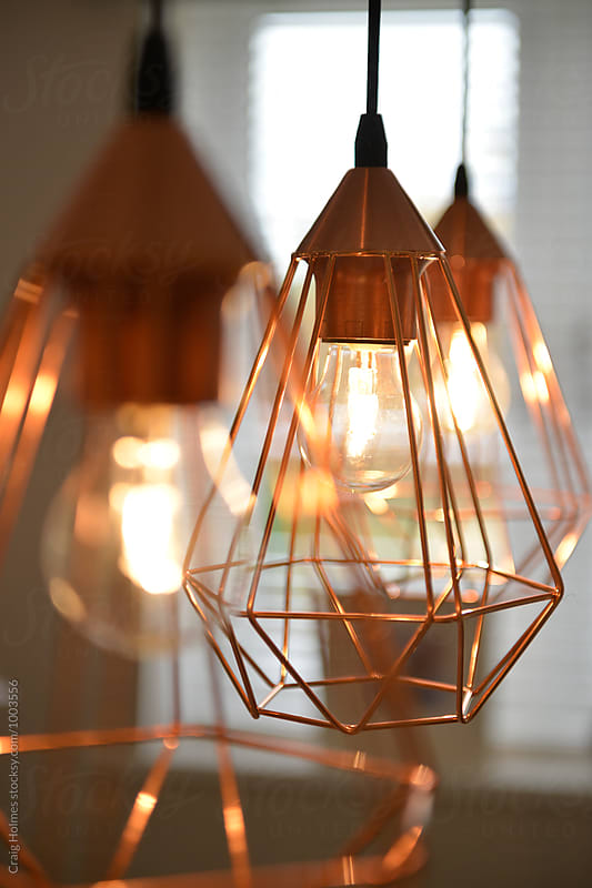 Rose gold colored lighting in a home setting. by Craig Holmes for Stocksy United