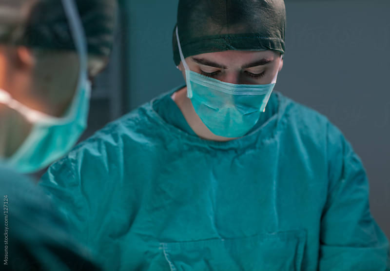 Close Up of a Surgeon in the OR by Mosuno for Stocksy United