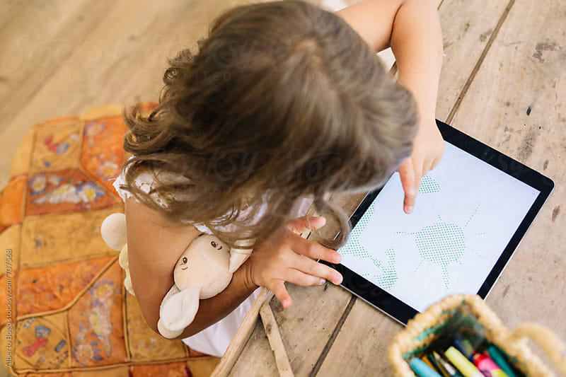 Girl Drawing on a Digital Tablet by Alberto Bogo for Stocksy United