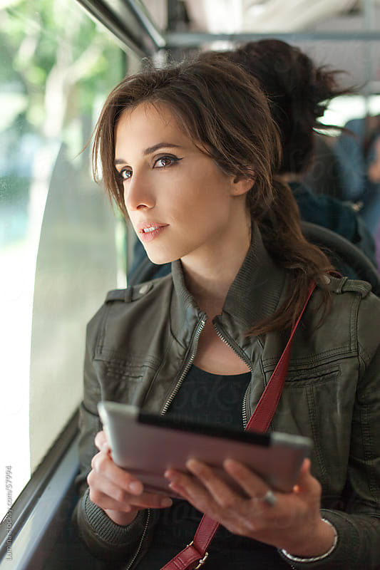 Woman Using Tablet on the Bus by Lumina for Stocksy United