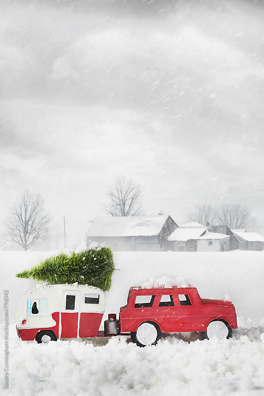 Toy car with trailer and tree in snow by Sandra Cunningham for Stocksy United