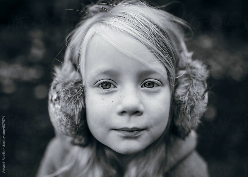 Portrait of A Little Girl with Earmuffs by Amanda Voelker for Stocksy United
