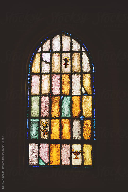 Stain glass window by Nate & Amanda Howard for Stocksy United