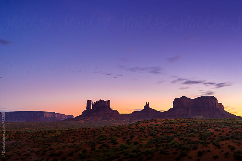 Monument Valley Utah USA Landscape At Dusk Under Colorful Purple Sky by JP Danko for Stocksy United