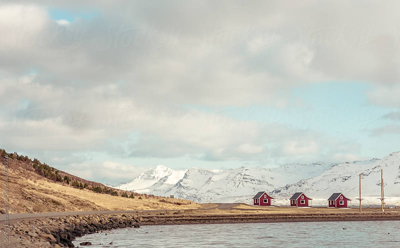 Traditional Icelandic houses by the sea and mountains in winter by Soren Egeberg for Stocksy United