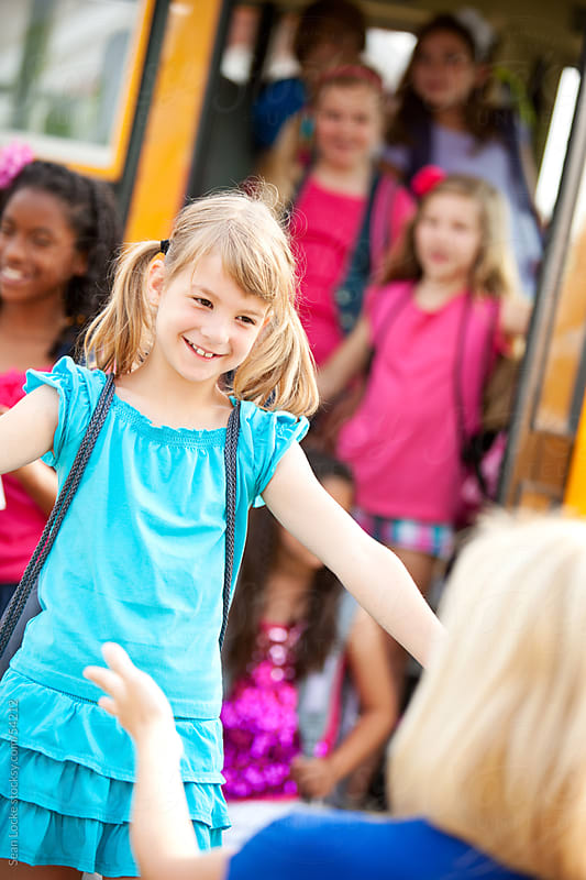 School Bus: Girl Ready to Hug Mother by Sean Locke for Stocksy United