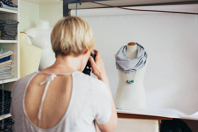 Self-Employment - Female Fashion Designer Photographing Scarf on Display Dummy in Bright Atelier by Julien L. Balmer for Stocksy United