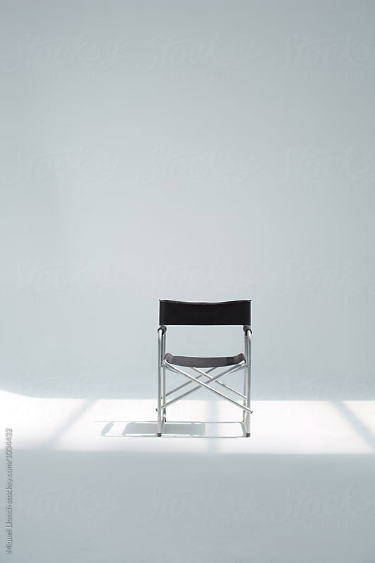 Director chair in a wihe sudio by Miquel Llonch for Stocksy United