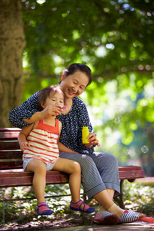 little girl with her grandmother by cuiyan Liu for Stocksy United