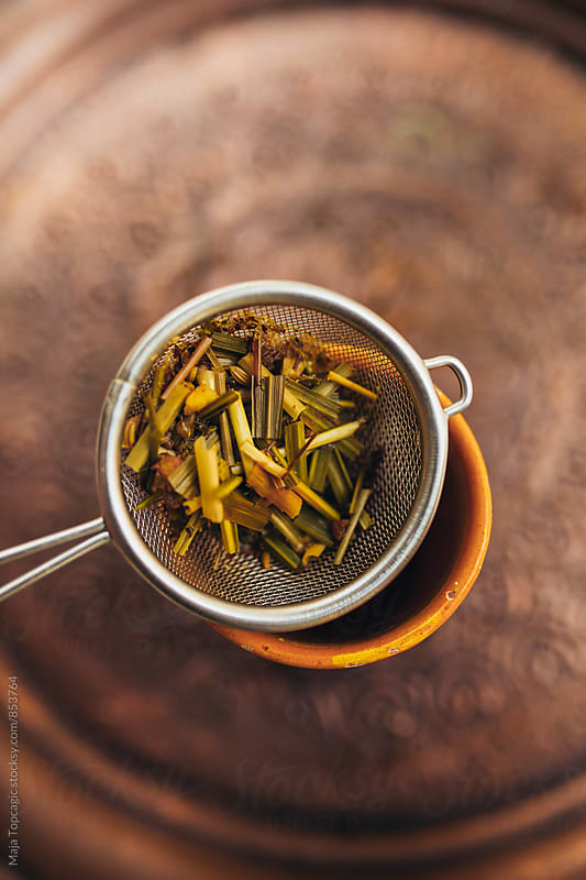 Herbal tea in a strainer by Maja Topcagic for Stocksy United