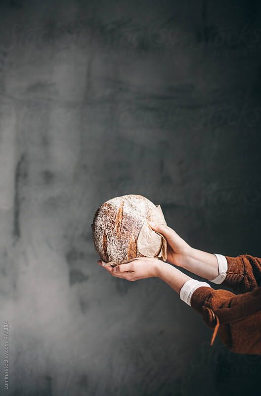 Woman Holding a Loaf of Bread by Lumina for Stocksy United