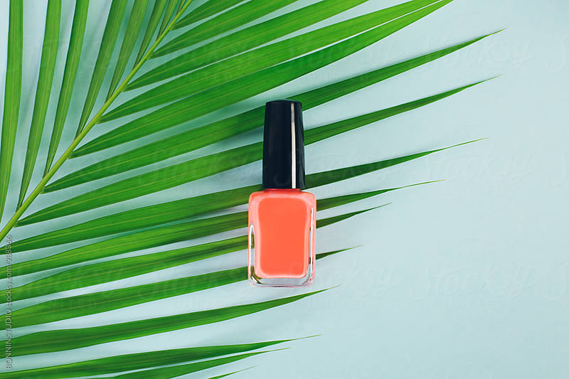 Orange nail polish bottle from above.  by BONNINSTUDIO for Stocksy United
