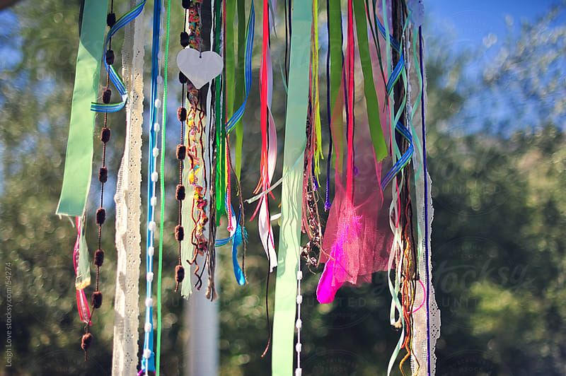 Colorful Garland Hangs Againt A Blue Sky Background by Leigh Love for Stocksy United