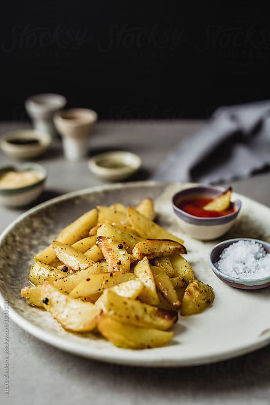 Roasted potatoes with spices by Tatjana Ristanic for Stocksy United