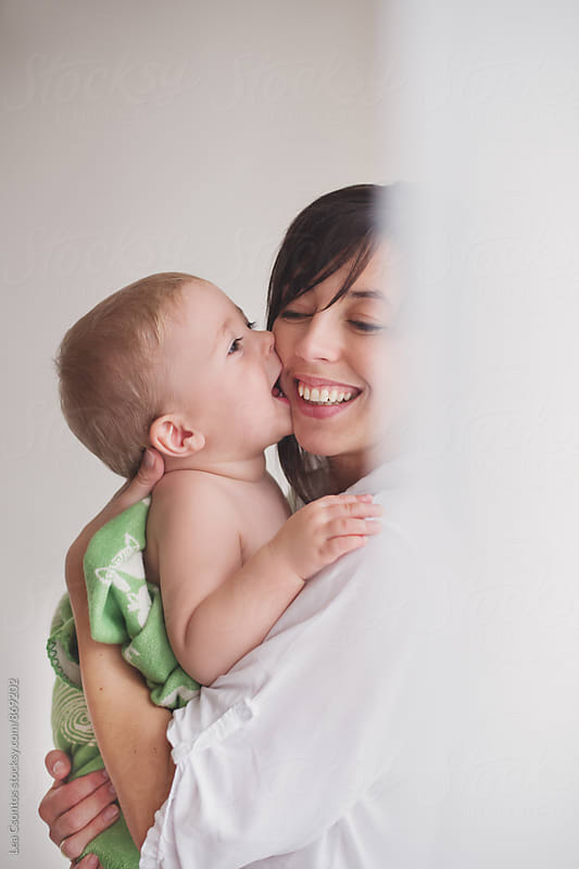 Little boy playing and snuggling with her happy mother. by Lea Csontos for Stocksy United