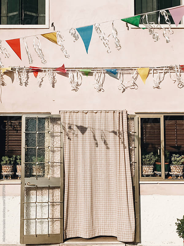 House decorated with flags, Pellestrina by michela ravasio for Stocksy United