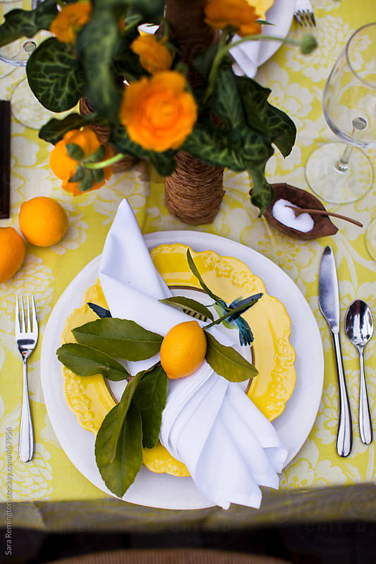 Yellow Table Setting With Lemons by Sara Remington for Stocksy United