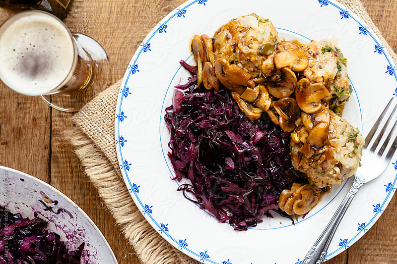 Herbed Bread Dumplings with Mushroom Gravy and Red Cabbage by Harald Walker for Stocksy United