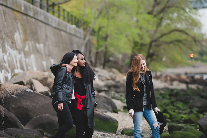 Female friends hanging out in the city by Lauren Naefe for Stocksy United